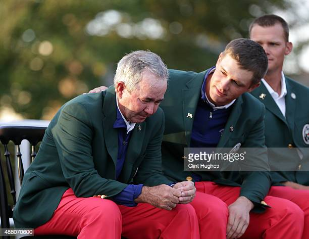 John Miller captain of the United States Walker Cup Team is consoled by Bryson DeChambeau during day two of the 2015 Walker Cup at Royal Lytham and...
