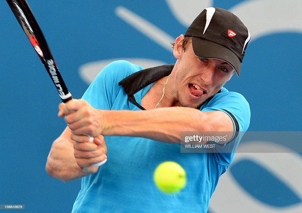 John Millman of Australia hits a backhand return on the way to victory over Tatsuma Ito of Japan in the first round at the Brisbane International tennis tournament on January 1, 2013. AFP PHOTO/William WEST USE