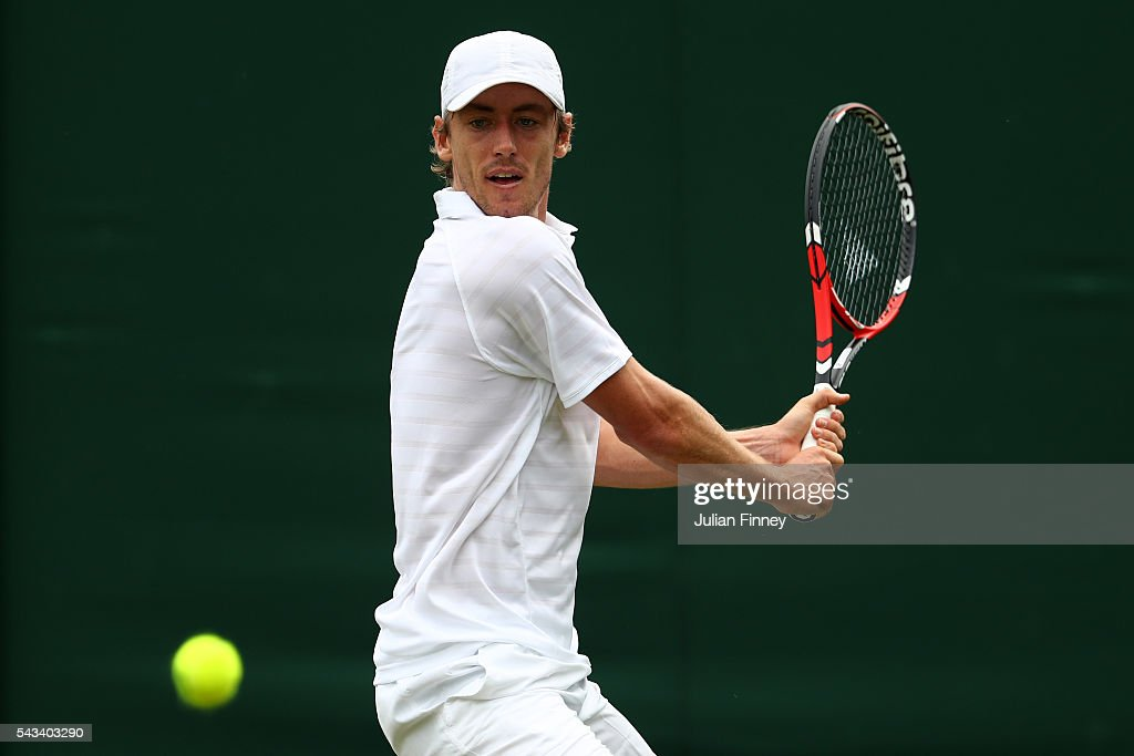 <a gi-track='captionPersonalityLinkClicked' href=/galleries/search?phrase=John+Millman&family=editorial&specificpeople=2082551 ng-click='$event.stopPropagation()'>John Millman</a> of Australia plays a backhand during the Men's Singles first round match against Albert Montanes of Spain on day two of the Wimbledon Lawn Tennis Championships at the All England Lawn Tennis and Croquet Club on June 28, 2016 in London, England.