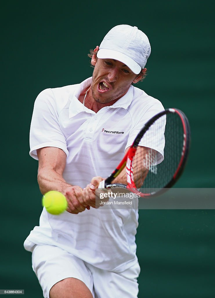 <a gi-track='captionPersonalityLinkClicked' href=/galleries/search?phrase=John+Millman&family=editorial&specificpeople=2082551 ng-click='$event.stopPropagation()'>John Millman</a> of Australia plays a backhand during the Men's Singles second round match against Benoit Pare of France on day four of the Wimbledon Lawn Tennis Championships at the All England Lawn Tennis and Croquet Club on June 30, 2016 in London, England.