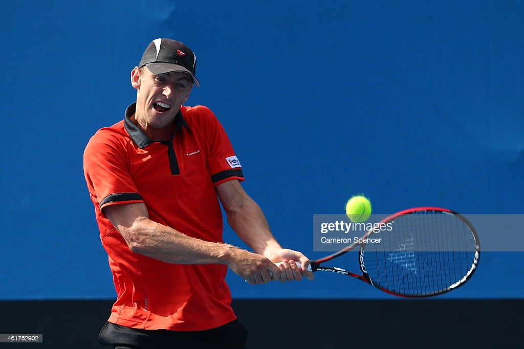 <a gi-track='captionPersonalityLinkClicked' href=/galleries/search?phrase=John+Millman&family=editorial&specificpeople=2082551 ng-click='$event.stopPropagation()'>John Millman</a> of Australia plays a backhand in his first round match against Leonardo Mayer of Argentina during day one of the 2015 Australian Open at Melbourne Park on January 19, 2015 in Melbourne, Australia.