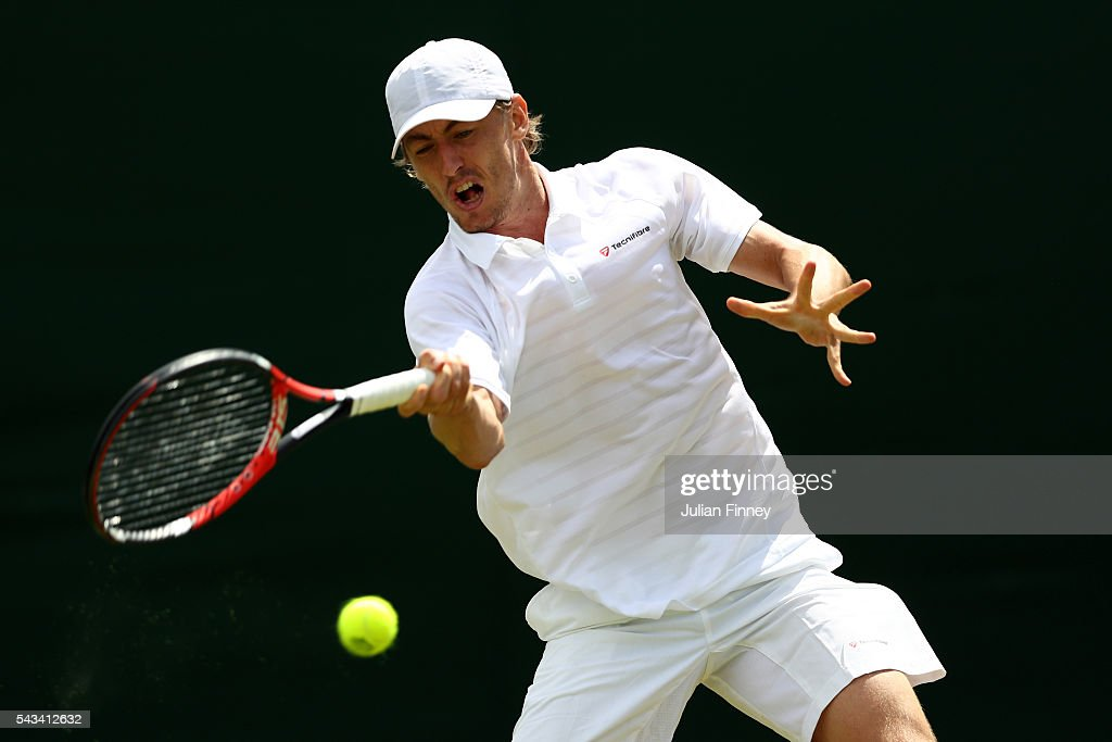 <a gi-track='captionPersonalityLinkClicked' href=/galleries/search?phrase=John+Millman&family=editorial&specificpeople=2082551 ng-click='$event.stopPropagation()'>John Millman</a> of Australia plays a forehand during the Men's Singles first round match against Albert Montanes of Spain on day two of the Wimbledon Lawn Tennis Championships at the All England Lawn Tennis and Croquet Club on June 28, 2016 in London, England.