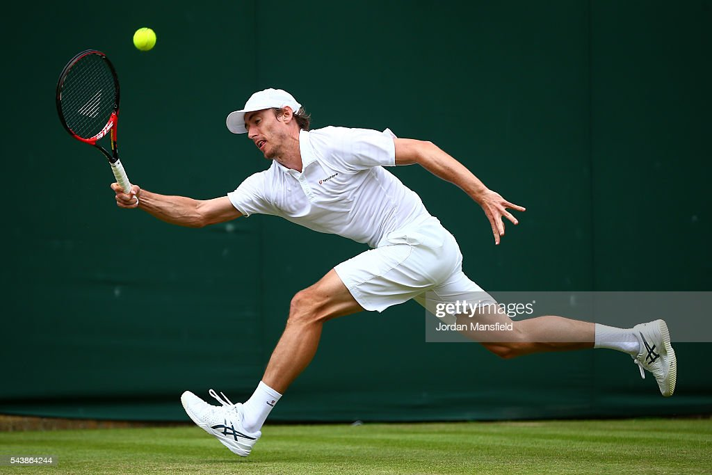 <a gi-track='captionPersonalityLinkClicked' href=/galleries/search?phrase=John+Millman&family=editorial&specificpeople=2082551 ng-click='$event.stopPropagation()'>John Millman</a> of Australia plays a forehand during the Men's Singles second round match against Benoit Pare of France on day four of the Wimbledon Lawn Tennis Championships at the All England Lawn Tennis and Croquet Club on June 30, 2016 in London, England.