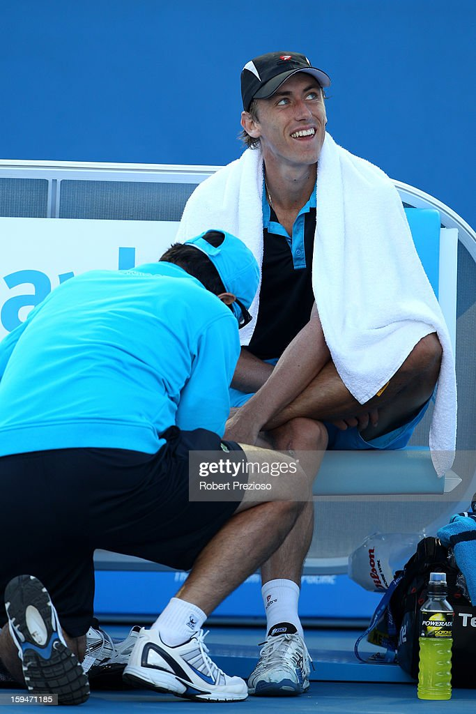 John Millman of Australia receives medical attention in his first round match against Tatsuma Ito of Japan during day one of the 2013 Australian Open at Melbourne Park on January 14, 2013 in Melbourne, Australia.