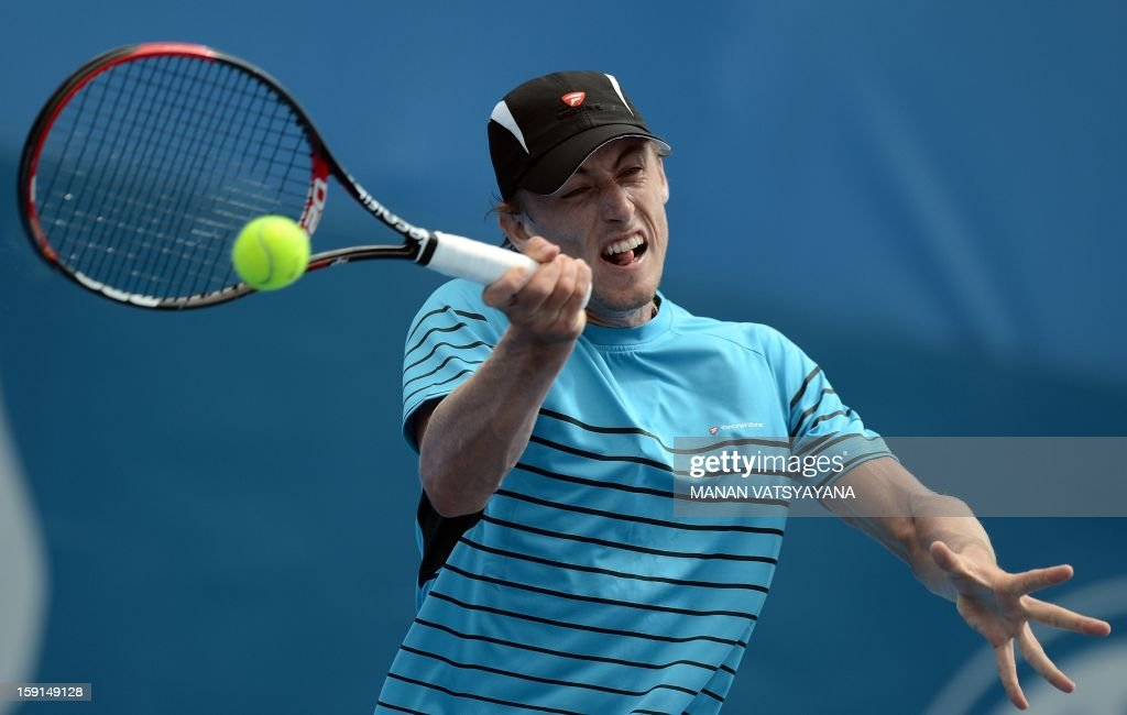 John Millman of Australia returns a shot against Andreas Seppi of Italy during their match at the Sydney International tennis tournament on January 9, 2013. AFP PHOTO / MANAN VATSYAYANA USE