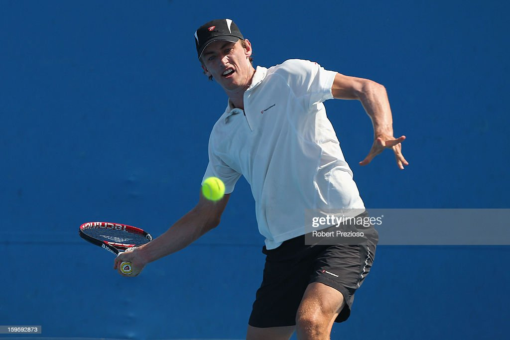 <a gi-track='captionPersonalityLinkClicked' href=/galleries/search?phrase=John+Millman&family=editorial&specificpeople=2082551 ng-click='$event.stopPropagation()'>John Millman</a> of Australia returns a shot in his first round doubles match with Matthew Barton of Australia against Daniel Gimeno-Traver of Spain and Marinko Matosevic of Australia during day four of the 2013 Australian Open at Melbourne Park on January 17, 2013 in Melbourne, Australia.