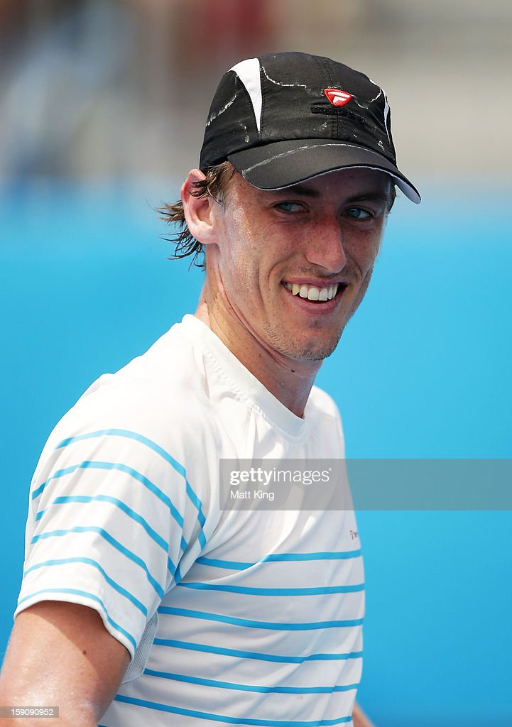 <a gi-track='captionPersonalityLinkClicked' href=/galleries/search?phrase=John+Millman&family=editorial&specificpeople=2082551 ng-click='$event.stopPropagation()'>John Millman</a> of Australia smiles at his coach after winning match point in his first round match against Tommy Robredo of Spain during day three of Sydney International at Sydney Olympic Park Tennis Centre on January 8, 2013 in Sydney, Australia.