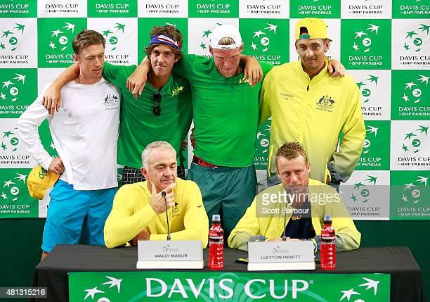 John Millman Thanasi Kokkinakis Sam Groth and Nick Kyrgios look on as Wally Masur captain of Australia and Lleyton Hewitt of Australia speak during a...