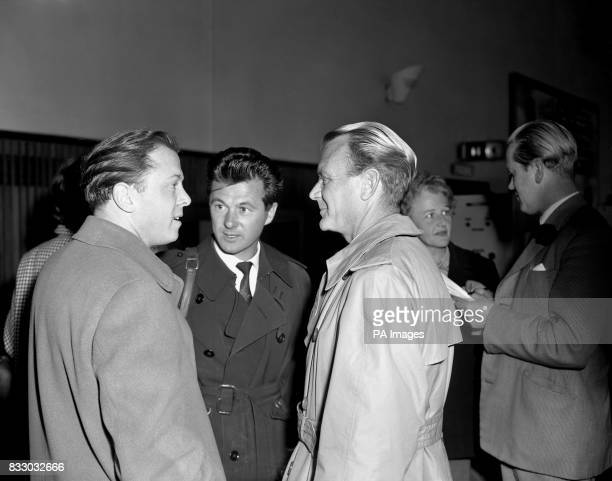 John Mills and Bryan Forbes are welcomed by Richard Attenborough on arrival at London Airport from the Mediterranean where they have been filming...