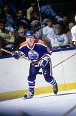 John Miner of the Edmonton Oilers skates on the ice during an NHL game against the New York Islanders on March 26 1988 at the Nassau Coliseum in...