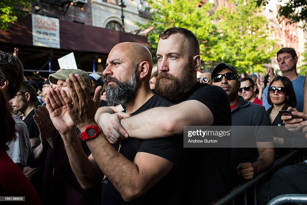 John Mirch, left, and Michael Camacho, right, participate in a Rally Against Hate, organized by members of New York's Lesbian-Gay-Transgender-Bisexual community, on May 20, 2013 in New York City. The rally was organized in response to a recent spate of hate crimes, most notably the murder of Mark Carson, a gay man who was shot in New York's West Village neighborhood in the early hours of May 18.
