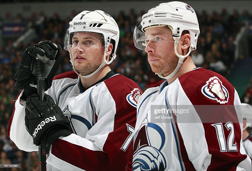 John Mitchell and Chuck Kobasew of the Colorado Avalanche take a break during an NHL game against the Vancouver Canucks at Rogers Arena March 28 2013...