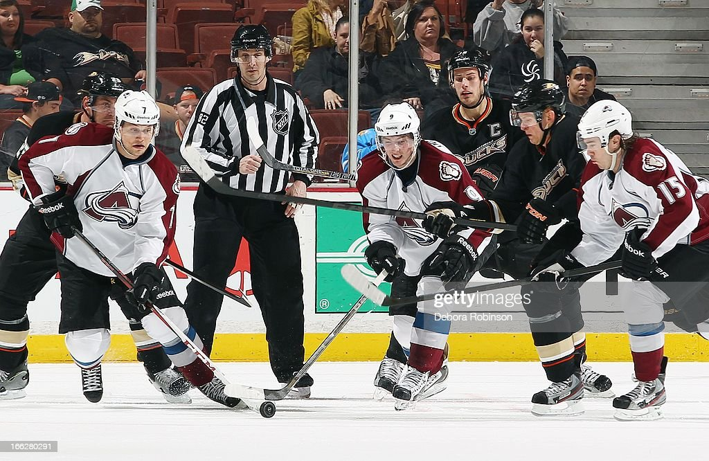 John Mitchell #7, Matt Duchene #9 and P.A. Parenteau #15 of the Colorado Avalanche work the puck past Francois Beauchemin #23, Ryan Getzlaf #15 and Corey Perry #10 of the Anaheim Ducks as linesman Ryan Galloway #82 observes the actionApril 10, 2013 at Honda Center in Anaheim, California.