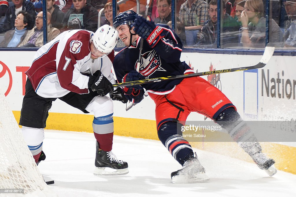 John Mitchell #7 of the Colorado Avalanche and <a gi-track='captionPersonalityLinkClicked' href=/galleries/search?phrase=Boone+Jenner&family=editorial&specificpeople=6480665 ng-click='$event.stopPropagation()'>Boone Jenner</a> #38 of the Columbus Blue Jackets battle for the puck during the third period on April 1, 2014 at Nationwide Arena in Columbus, Ohio. Colorado defeated Columbus 3-2 in overtime.