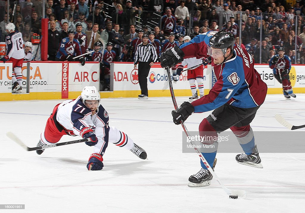 John Mitchell #7 of the Colorado Avalanche shoots past <a gi-track='captionPersonalityLinkClicked' href=/galleries/search?phrase=Nick+Foligno&family=editorial&specificpeople=537821 ng-click='$event.stopPropagation()'>Nick Foligno</a> #71 the Columbus Blue Jackets at the Pepsi Center on January 24, 2013 in Denver, Colorado. The Avalanche defeate the Blue Jackets 4-0.