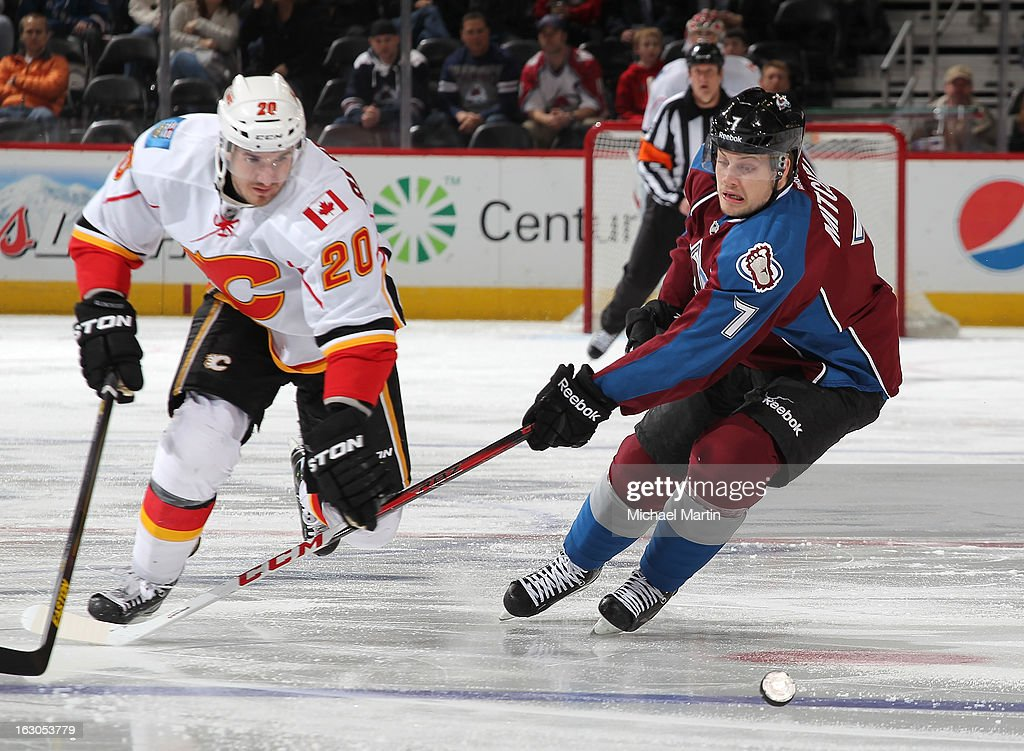 John Mitchell #7 of the Colorado Avalanche skates against <a gi-track='captionPersonalityLinkClicked' href=/galleries/search?phrase=Curtis+Glencross&family=editorial&specificpeople=2190970 ng-click='$event.stopPropagation()'>Curtis Glencross</a> #20 of the Calgary Flames at the Pepsi Center on February 28, 2013 in Denver, Colorado. Colorado beat Calgary 5-4.