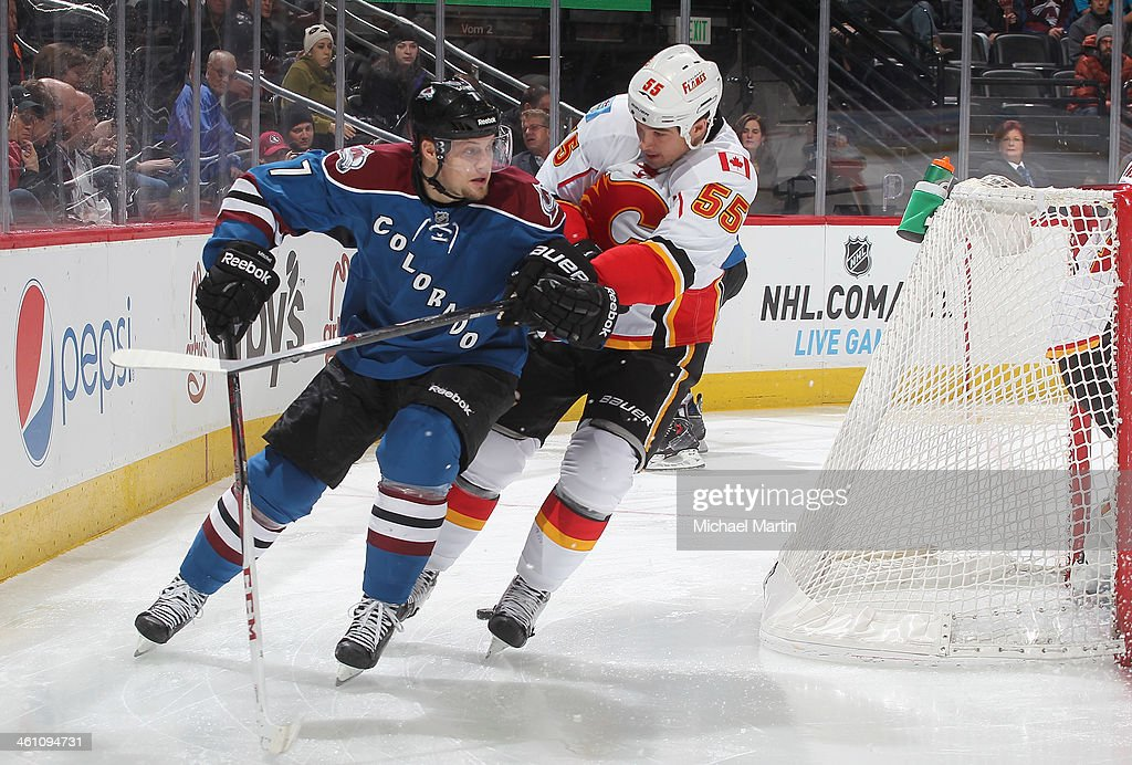 John Mitchell #7 of the Colorado Avalanche skates against <a gi-track='captionPersonalityLinkClicked' href=/galleries/search?phrase=Shane+O%27Brien&family=editorial&specificpeople=2190942 ng-click='$event.stopPropagation()'>Shane O'Brien</a> #55 of the Calgary Flames at the Pepsi Center on January 06, 2014 in Denver, Colorado. The Flames defeated the Avalanche 4-3.