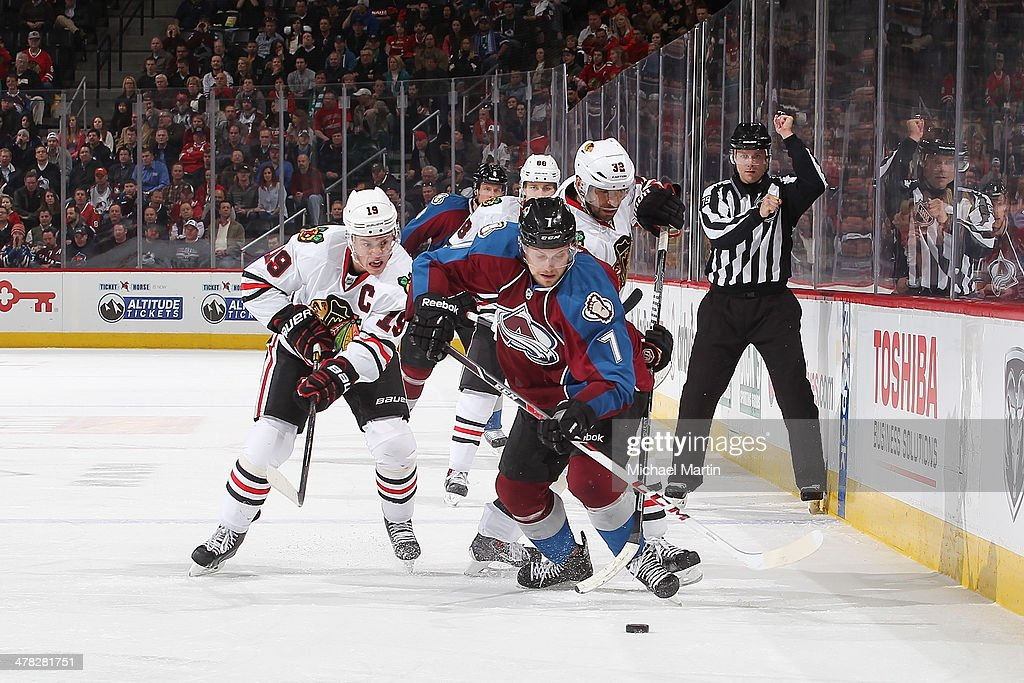 John Mitchell #7 of the Colorado Avalanche skates with the puck as <a gi-track='captionPersonalityLinkClicked' href=/galleries/search?phrase=Jonathan+Toews&family=editorial&specificpeople=537799 ng-click='$event.stopPropagation()'>Jonathan Toews</a> #19 of the Chicago Blackhawks pursues at the Pepsi Center on March 12, 2014 in Denver, Colorado. The Avalanche defeated the Blackhawks 3-2.