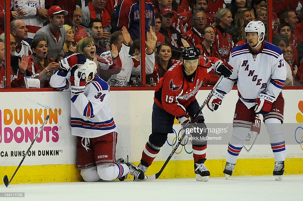 John Mitchell #34 of the New York Rangers reacts after being hit with a high-stick from <a gi-track='captionPersonalityLinkClicked' href=/galleries/search?phrase=Jeff+Halpern&family=editorial&specificpeople=206583 ng-click='$event.stopPropagation()'>Jeff Halpern</a> #15 of the Washington Capitals in Game Six of the Eastern Conference Semifinals during the 2012 NHL Stanley Cup Playoffs at Verizon Center on May 9, 2012 in Washington, DC.