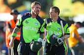 John Mooney and Niall O'Brien of Ireland celebrate after winning the 2015 ICC Cricket World Cup match between the West Indies and Ireland at Saxton...