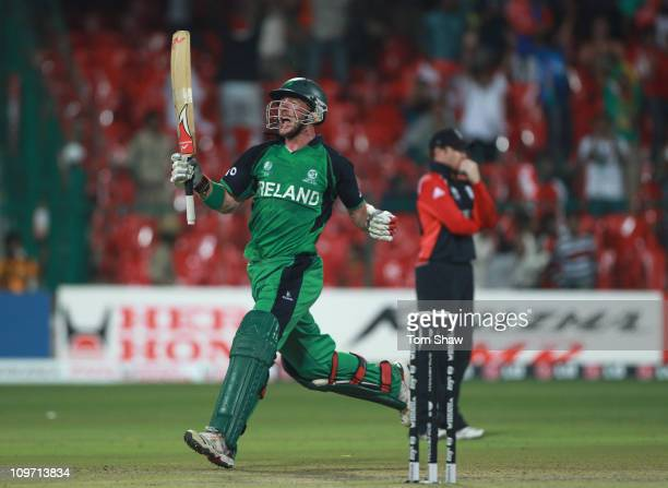 John Mooney of Ireland celebrates after scoring the winning runs during the 2011 ICC World Cup Group B match between England and Ireland at the M...