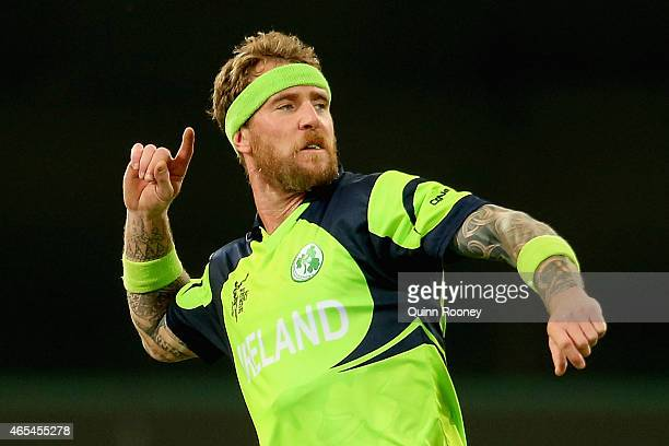 John Mooney of Ireland celebrates getting the wicket of Sikandar Raza of Zimbabwe during the 2015 ICC Cricket World Cup match between Zimbabwe and...