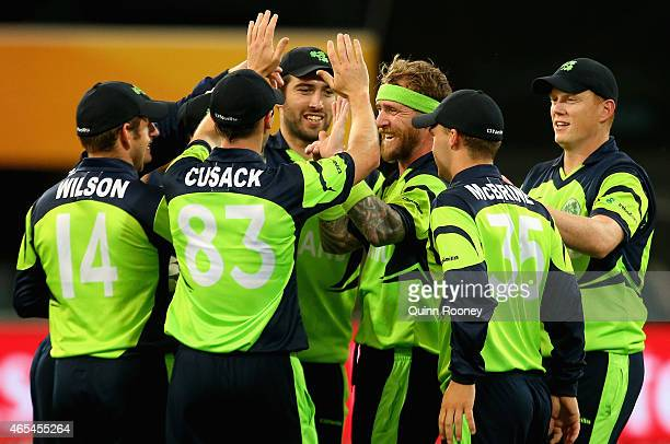 John Mooney of Ireland is congratulated by team mates after getting the wicket of Sikandar Raza of Zimbabwe during the 2015 ICC Cricket World Cup...