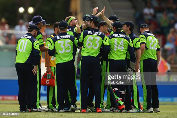 John Mooney of South Africa celebrates with his team mates after taking the wicket of Quinton de Kock of South Africa during the 2015 ICC Cricket...