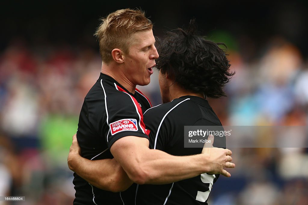 John Moonlight and Nathan Hirayama of Canada celebrate a try during the cup quarter final match between Wales and Canada day three of the 2013 Hong...