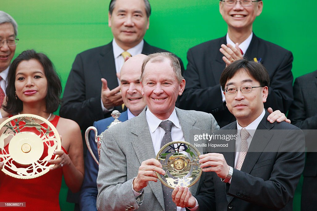 John Moore accepts his trophy for winning the Group 1 The Champions Mile with Dan Excel during The Champions Mile meeting at Sha Tin racecourse on May 5, 2013, in Hong Kong, Hong Kong.