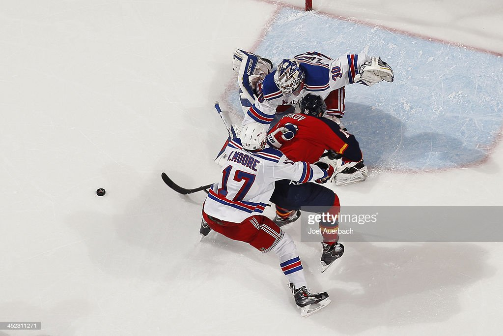 John Moore #17 assists goaltender Henrik Lundqvist #30 of the New York Rangers defend the net against a shot by <a gi-track='captionPersonalityLinkClicked' href=/galleries/search?phrase=Aleksander+Barkov&family=editorial&specificpeople=8760147 ng-click='$event.stopPropagation()'>Aleksander Barkov</a> #16 of the Florida Panthers at the BB&T Center on November 27, 2013 in Sunrise, Florida. The Rangers defeated the Panthers 5-2.