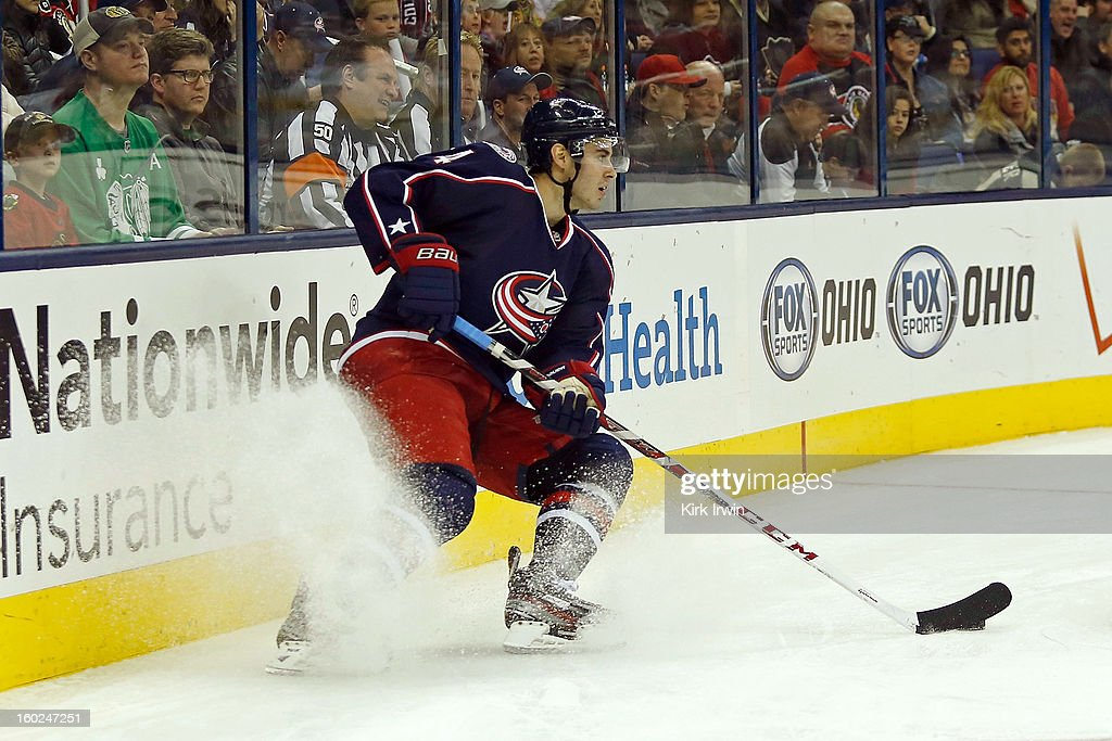 John Moore #4 of the Columbus Blue Jackets skates with the puck during the game against the Chicago Blackhawks on January 26, 2013 at Nationwide Arena in Columbus, Ohio.