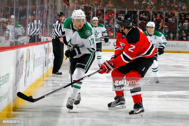John Moore of the New Jersey Devils and Devin Shore of the Dallas Stars skate for position during the game on March 26 2017 at Prudential Center in...