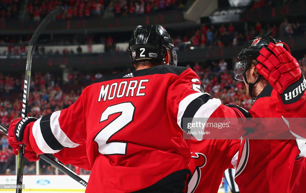 John Moore #2 of the New Jersey Devils celebrates after scoring a goal agaunst the Colorado Avalanche looks during the Devils season opener at Prudential Center on October 7, 2017 in Newark, New Jersey.