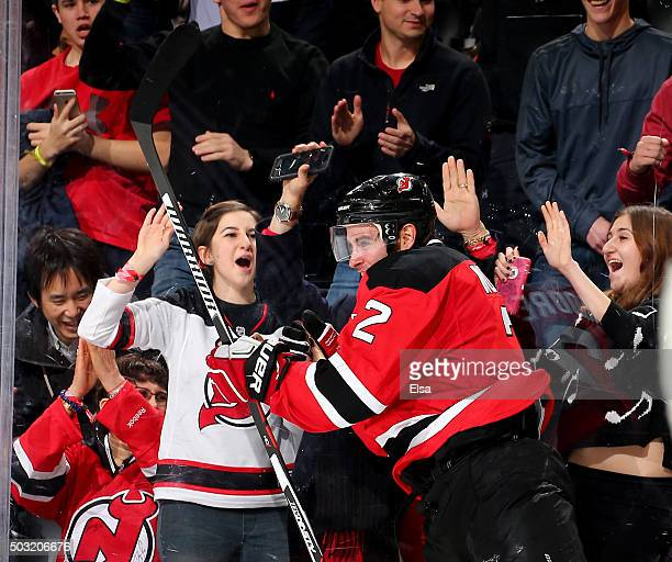 John Moore of the New Jersey Devils celebrates his game winning goal in overtime against the Dallas Stars on January 22016 at Prudential Center in...