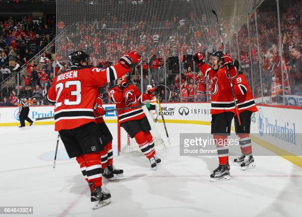 John Moore of the New Jersey Devils celebrates his game winning overtime goal at 59 seconds against the Philadelphia Flyers at the Prudential Center...
