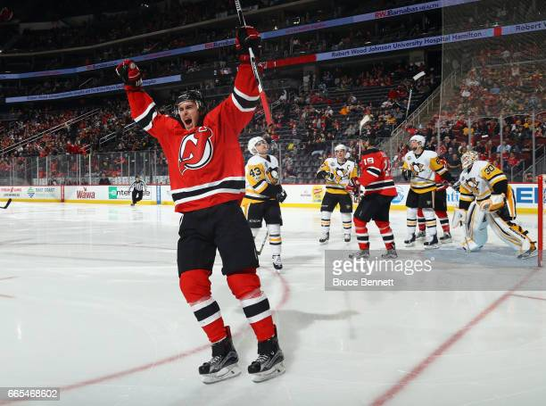 John Moore of the New Jersey Devils celebrates his goal at 10 seconds of the second period against the Pittsburgh Penguins at the Prudential Center...