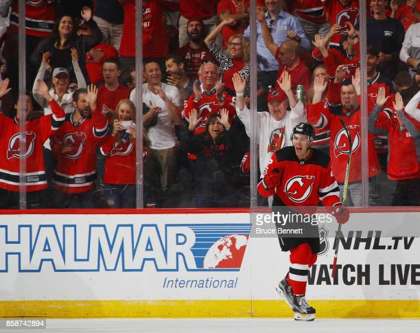 John Moore of the New Jersey Devils celebrates his shorthanded goal at 1400 of the third period against the Colorado Avalanche at the Prudential...