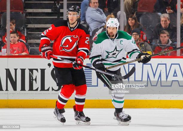 John Moore of the New Jersey Devils in action against Jamie Benn of the Dallas Stars on March 26 2017 at Prudential Center in Newark New Jersey The...