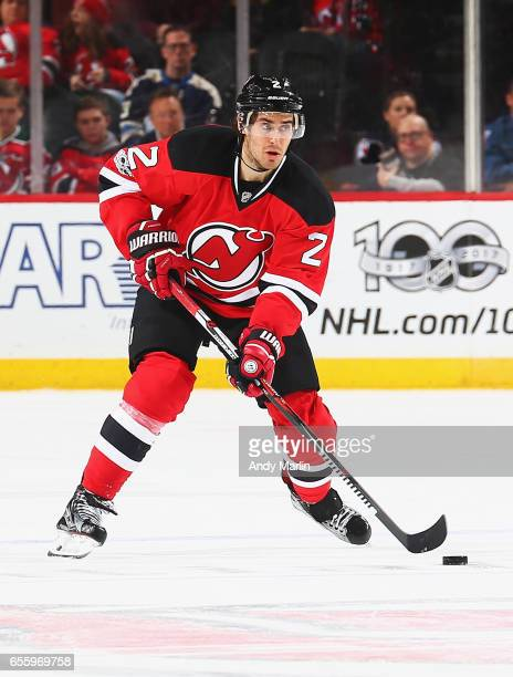 John Moore of the New Jersey Devils plays the puck against the Columbus Blue Jackets during the game at Prudential Center on March 19 2017 in Newark...