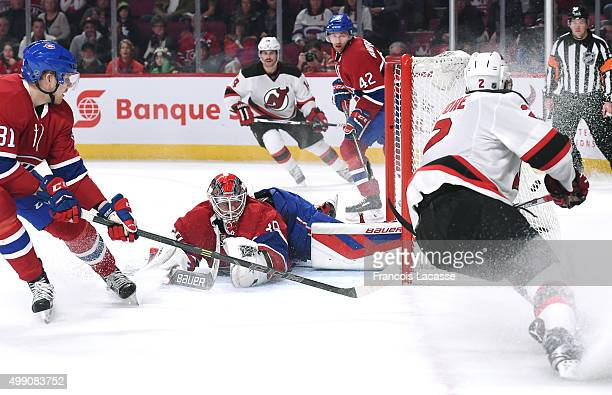 John Moore of the New Jersey Devils scores a goal on goaltender Mike Condon the Montreal Canadiens in the NHL game at the Bell Centre on November 28...