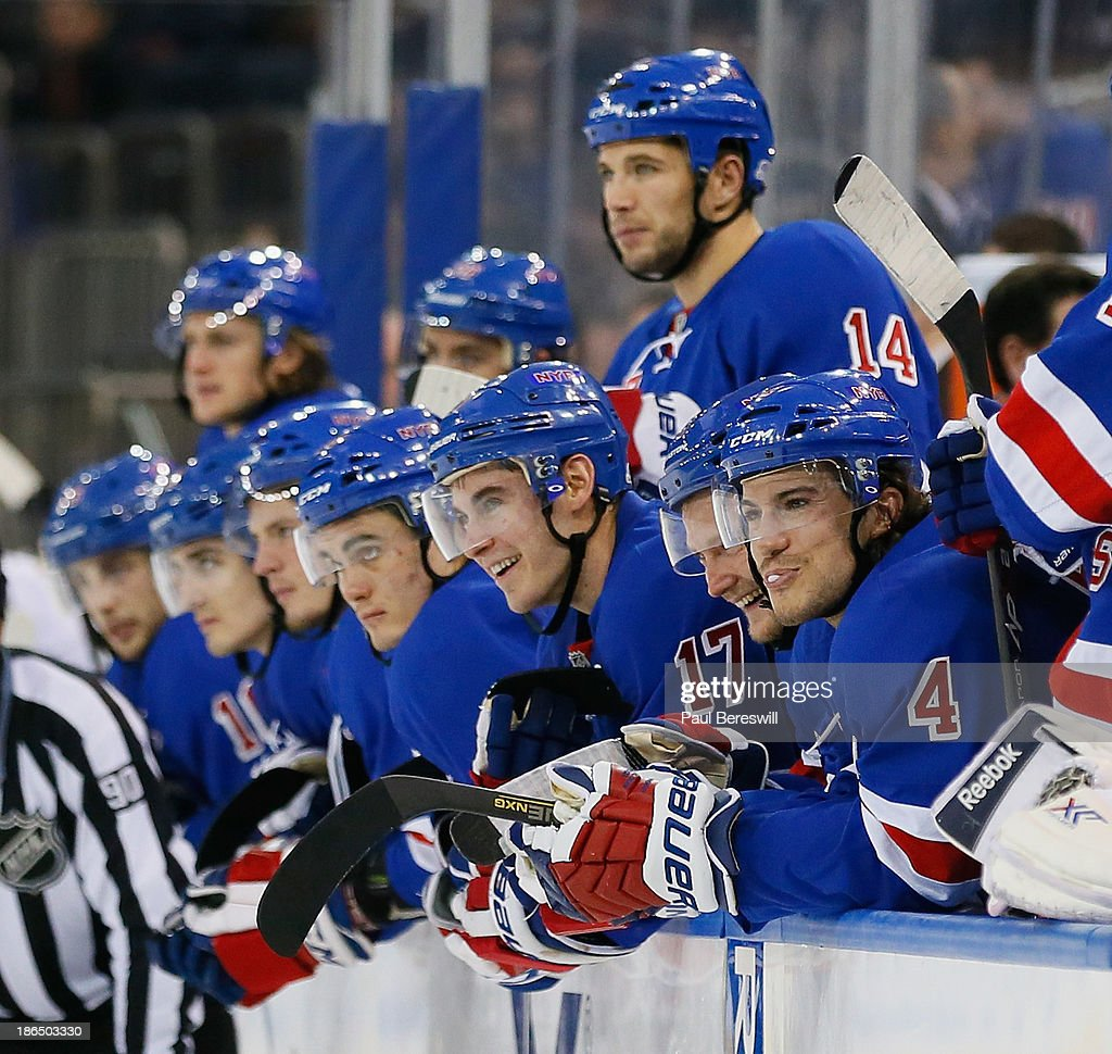 John Moore #17 of the New York Rangers and teammates watch the closing seconds of their 2-0 win over the Buffalo Sabres in an NHL hockey game at Madison Square Garden on October 31, 2013 in New York City.