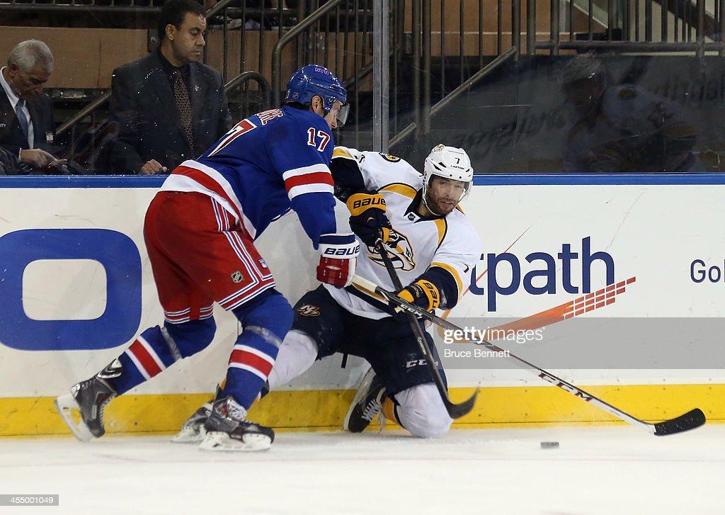 John Moore #17 of the New York Rangers checks Matt Cullen #7 of the Nashville Predators at Madison Square Garden on December 10, 2013 in New York City. The Predators defeated the Rangers 4-1.