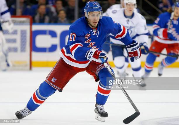 John Moore of the New York Rangers plays in the game against the Tampa Bay Lightning at Madison Square Garden on December 1 2014 in New York New York