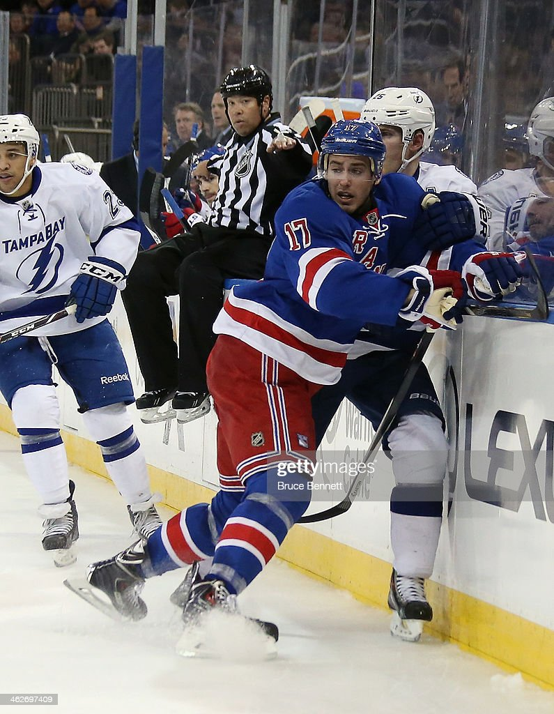 John Moore #17 of the New York Rangers skates against the Tampa Bay Lightning at Madison Square Garden on January 14, 2014 in New York City. The Lightning defeated the Rangers 2-1.