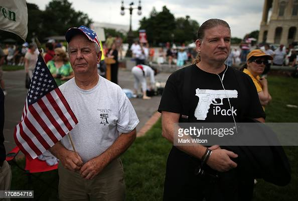 John Moorefield and Steve Shafer attend a Tea Party rally at the US Capitol June 19 2013 in Washington DC The group Tea Party Patriots hosted the...
