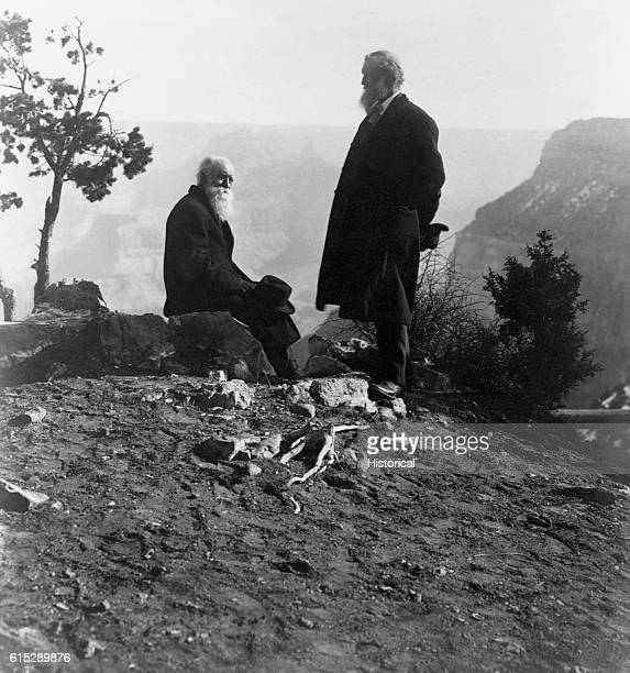 John Muir and John Burroughs stand on a mountain top Muir was an American naturalist who campaigned for the establishment of Yosemite Park Burroughs...