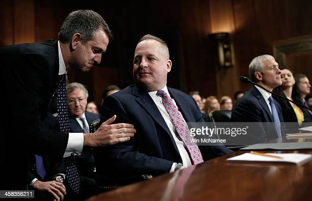 John Mulligan executive vice president and CIO of Target Corporation confers with attorney Stuart Ingis prior to testimony before the Senate...