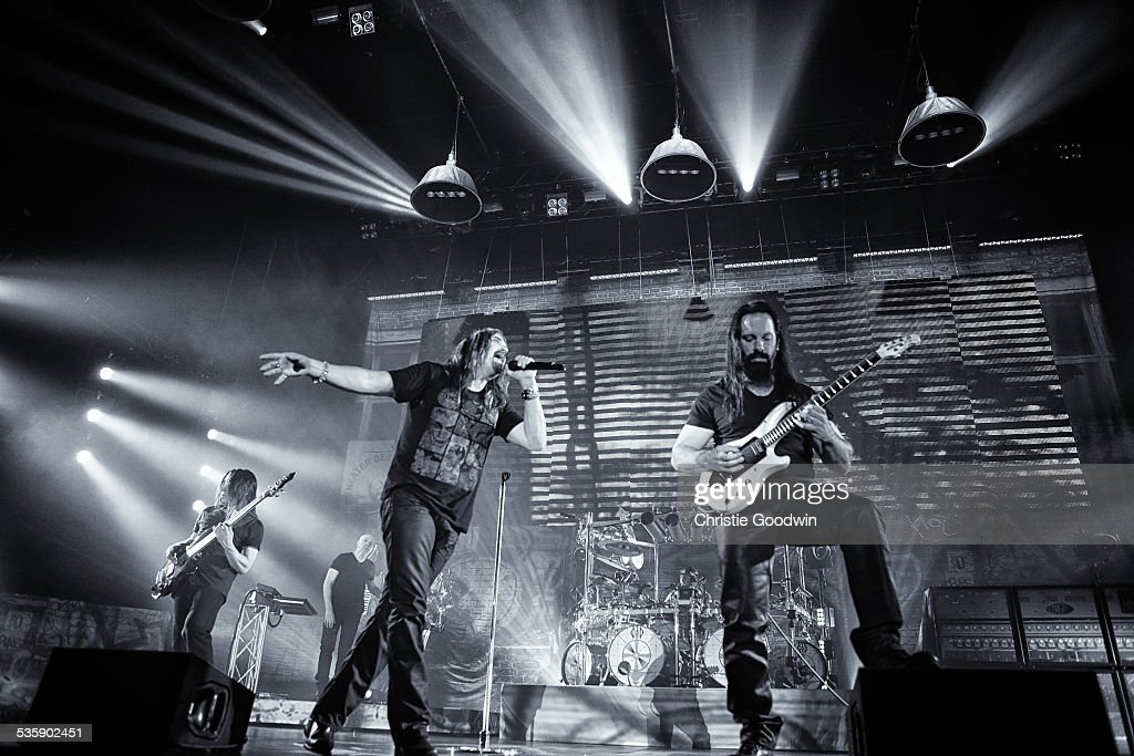 John Myung, Jordan Rudess, James LaBrie, Mike Mangini and John Petrucci of Dream Theater perform at Wembley Arena on February 14, 2014 in London, England.