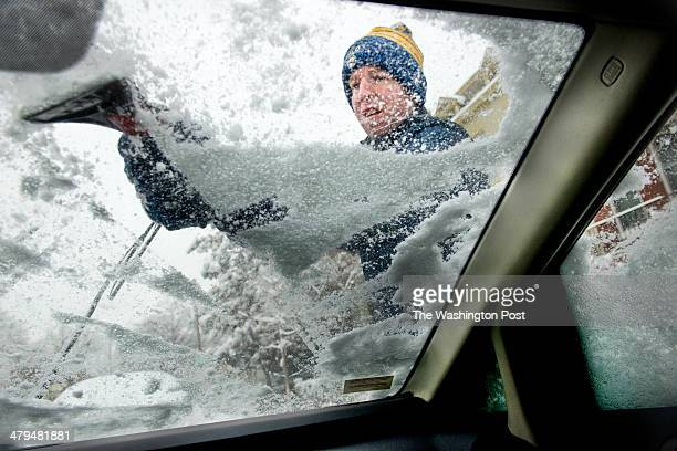 John Neal scrapes ice and snow from his car in Washington DC on March 17 2014 Neal who is originally from Buffalo NY is no stranger to heavy snow The...
